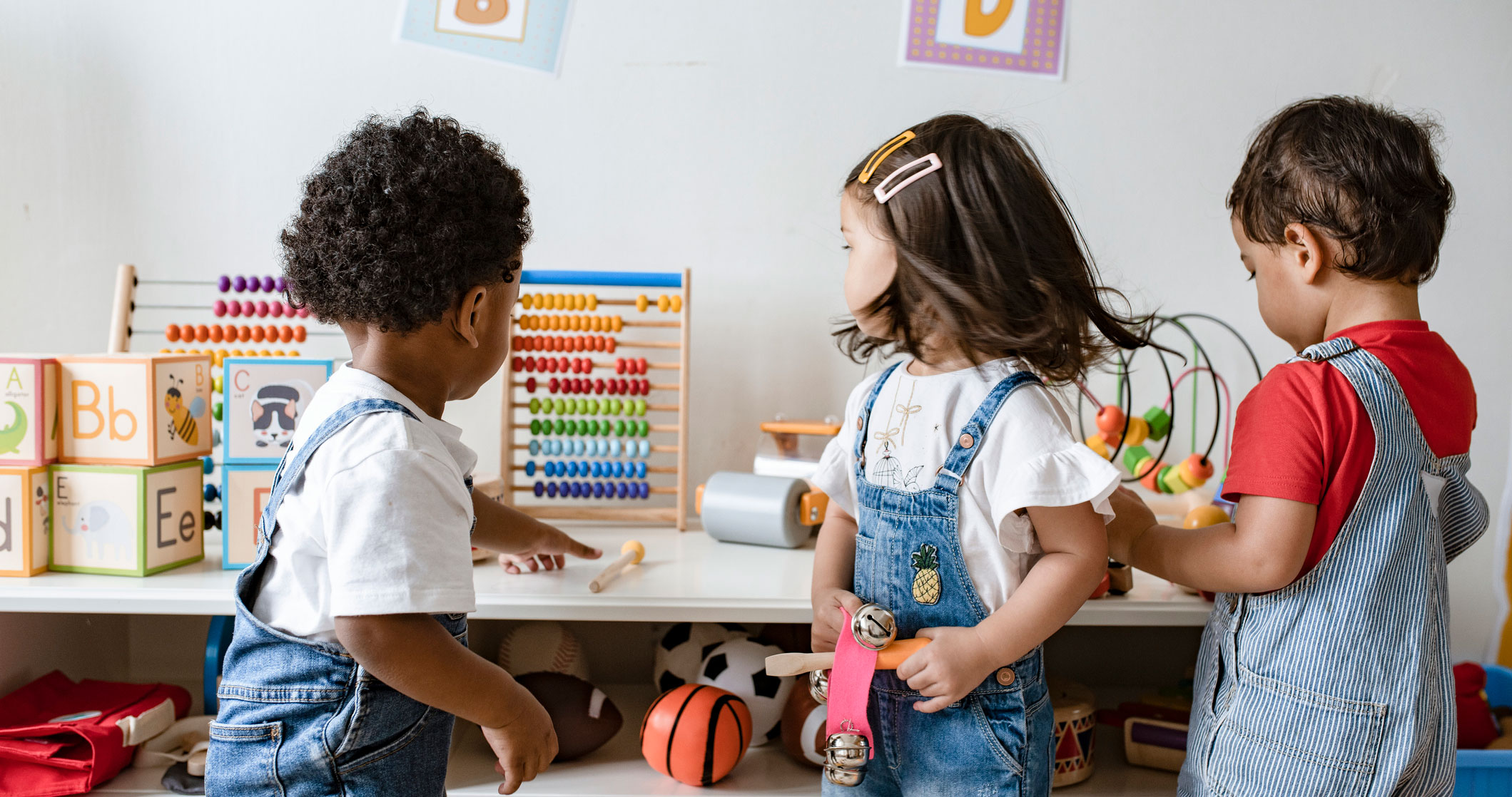 Preschool children playing with educational toys.